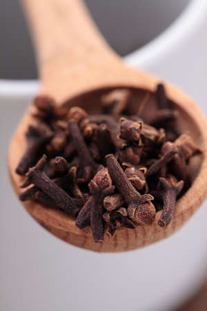 middle eastern food: Cloves in a wooden spoon Stock Photo