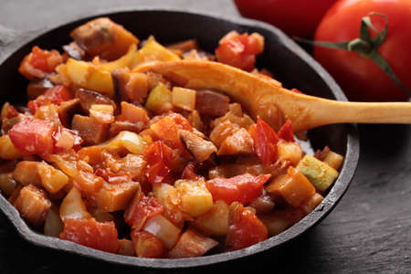 marrow squash: Ratatouille in an iron pan on a rustic table