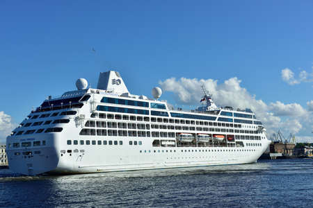 cruise liner: St. Petersburg, Russia - June 27, 2015: Cruise liner Ocean Princess of Princess Cruises company departs from the Neva river. The ship provide luxury cruise for 680 guests Editorial