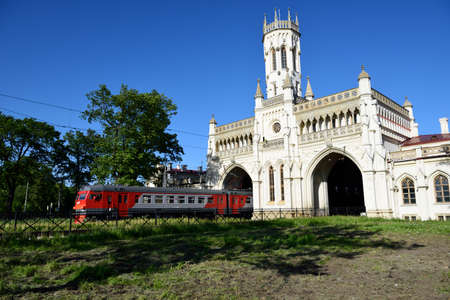 commuter train: St. Petersburg, Russia - June 07, 2015: Commuter train departs from the train station Novy Peterhof. The station was built in 1854-1857 by design of N Benois