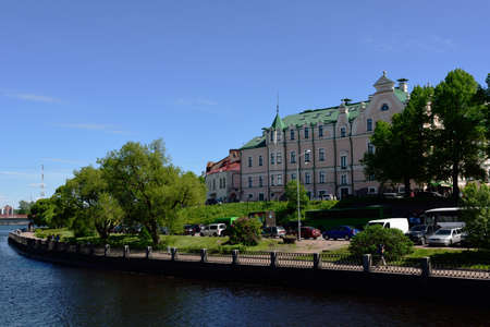 vyborg: Vyborg, Leningrad oblast, Russia - June 06, 2015: People on the embankment of Vyborg gulf. Before 1940, Vyborg was the second largest city of Finland Editorial