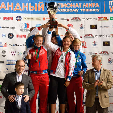 champion spain: Moscow, Russia - July 19, 2015: Team Russia with prizes during the Beach Tennis World Team Championship. Italy become world champion, Russia won silver, and Spain got bronze