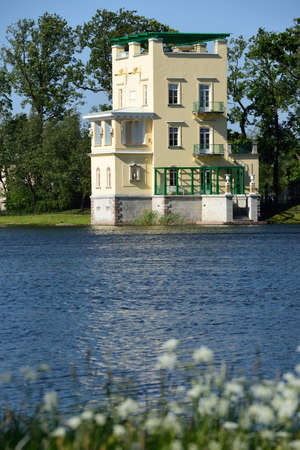 olgas: Peterhof, St. Petersburg, Russia - June 7, 2015: Olgas pavilion on the Olgas pond in a summer day. The pavilion was built for the Grand Duchess Olga Nikolaevna in 1846-1848