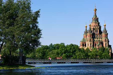 olgas: Peterhof, St. Petersburg, Russia - June 07, 2015: Saints Peter and Paul Cathedral viewed from Olgas pond. Built in 1905 by design of Nikolay Sultanov, it is a superb example of Russian Revival architecture Editorial