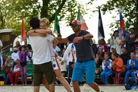 finalist: Moscow, Russia - July 18, 2015: Daria Churakova center, Nikita Burmakin left and Stanislav Zaichenko of Russia celebrate first time reaching the final of ITF Beach Tennis World Team Championship