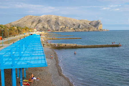 sudak: Sudak, Crimea, Ukraine - September 22, 2006: People resting on the public beach. It the only town in Crimea, which has beaches of quartz sand