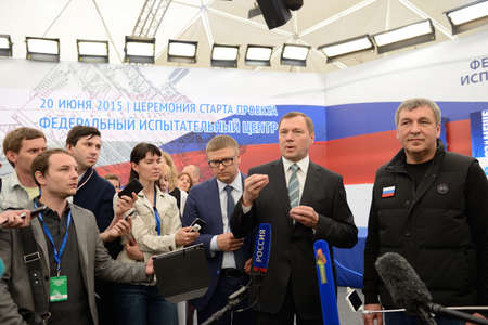 st  pete: St. Petersburg, Russia - June 20, 2015: General director of JSC Russian Grids Oleg Budargin center talk with press during the presentation of the project of the Federal Test Center for electrical equipment. The event is included in the program of St. Pete