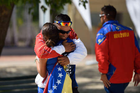 double game: Moscow, Russia - July 17, 2015: Ramon Guedez congratulates Lady Correa of Venezuela after the victory in a rubber of the match of Beach Tennis World Team Championship against Spain. Spain won the match 2-1