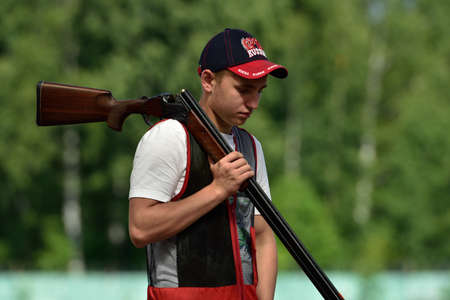 St. Petersburg, Russia - August 4, 2015: Unidentified athlete with shotgun during the Russian championships in trap shooting. Members of the National team of Russia will be determined after the competitions