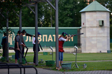 routed: St. Petersburg, Russia - August 4, 2015: Unidentified athletes with shotguns during the Russian championships in trap shooting. Members of the National team of Russia will be determined after the competitions