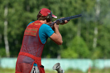 routed: St. Petersburg, Russia - August 4, 2015: Unidentified athlete with shotgun during the Russian championships in trap shooting. Members of the National team of Russia will be determined after the competitions
