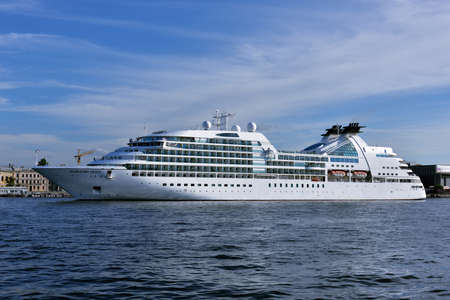 cruise liner: St. Petersburg, Russia - August 5, 2015: Cruise liner Seabourn Quest departs from the Neva river. The ship built in 2011 provides luxury cruise for 450 guests
