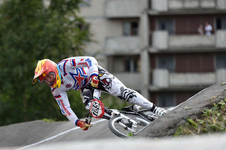 berm: St. Petersburg, Russia - August 6, 2015: Unidentified biker on the berm in the BMX race Cruiser. The competitions is a stage of the BMX racing championship of Russia Editorial