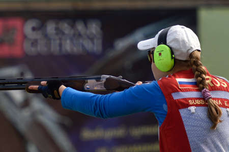 routed: St. Petersburg, Russia - August 4, 2015: Ekaterina Subbotina with shotgun during the Russian championships in trap shooting. Members of the National team of Russia will be determined after the competitions Editorial