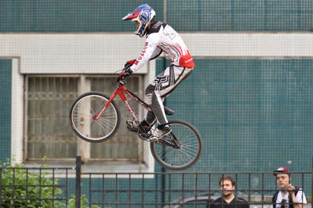 spectators: St. Petersburg, Russia - August 6, 2015: Spectators watch the unidentified biker in the BMX race Cruiser. The competitions is a stage of the BMX racing championship of Russia Editorial