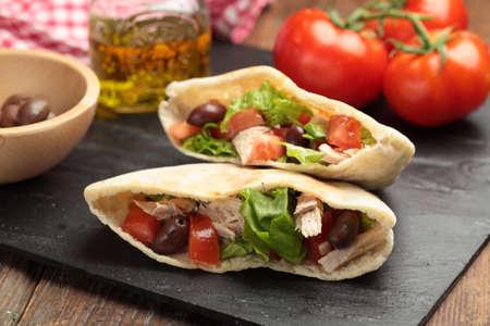 pita bread: Pita bread stuffed with turkey meat, tomato, kalamata olives, and lettuce