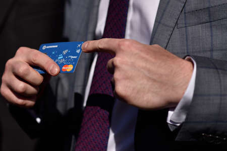 anton: St. Petersburg, Russia - August 17, 2015: Vice president and senior business development manager of Mastercard in Russia Anton Shigapov demonstrate the PayPass technology in urban transport ticketing system Editorial