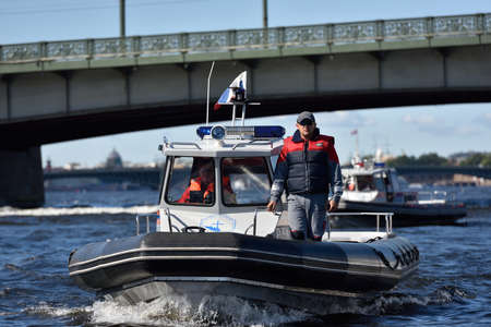 motorboat: St. Petersburg, Russia - August 15, 2015: Search and Rescue Service boats during the River marathon Oreshek Fortress race. This international motorboat competitions is held since 2003 Editorial