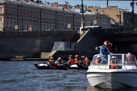 motorboat: St. Petersburg, Russia - August 15, 2015: Unidentified riders prepare to the start of the River marathon Oreshek Fortress race. This international motorboat competitions is held since 2003 Editorial