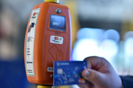 ticketing: St. Petersburg, Russia - August 17, 2015: Ticket vending machine supporting the MasterCard PayPass technology. The upgraded cashless ticketing system was demonstrated to media representatives in 3rd trolleybus depot Editorial