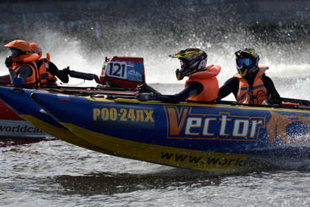 motorboat: St. Petersburg, Russia - August 15, 2015: Unidentified riders go to the start of the River marathon Oreshek Fortress race. This international motorboat competitions is held since 2003 Editorial