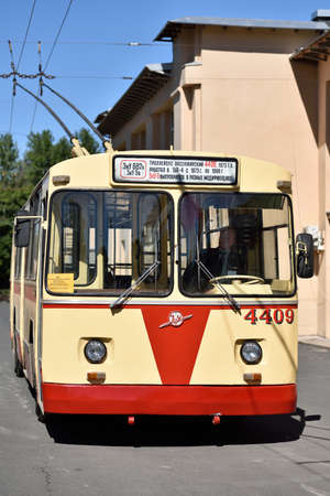 ticketing: St. Petersburg, Russia - August 17, 2015: Driver in the old  trolley bus during the demonstration of the new cashless ticketing system supported MasterCard PayPass technology