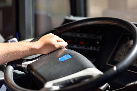 ticketing: St. Petersburg, Russia - August 17, 2015: Driver holds the steering wheel of a trolley bus during the demonstration of the new cashless ticketing system supported MasterCard PayPass technology Editorial