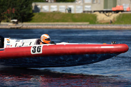 motorboat: St. Petersburg, Russia - August 15, 2015: I. Pylaev of Russia competes in the River marathon Oreshek Fortress race. This international motorboat competitions is held since 2003