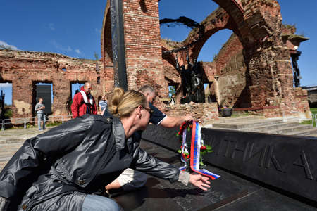 motorboat: Oreshek fortress, Leningrad oblast, Russia - August 15, 2015: Athletes laying flowers to the monument to the defenders of the fortress Oreshek during the River marathon Oreshek Fortress race. This international motorboat competitions is held since 2003