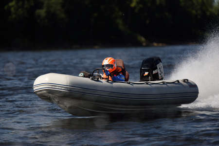 motorboat: St. Petersburg, Russia - August 15, 2015: Unidentified riders compete in the River marathon Oreshek Fortress race. This international motorboat competitions is held since 2003