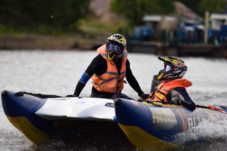 motorboat: St. Petersburg, Russia - August 15, 2015: Irina Krylova right and Dmitry Krylov compete the River marathon Oreshek Fortress race. This international motorboat competitions is held since 2003