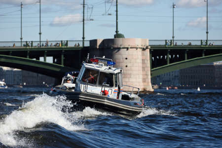 motorboat: St. Petersburg, Russia - August 15, 2015: Search and Rescue Service boat during the River marathon Oreshek Fortress race. This international motorboat competitions is held since 2003 Editorial