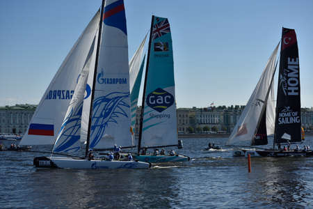 St. Petersburg, Russia - August 21, 2015: Extreme 40 catamarans during the 2nd day of St. Petersburg stage of Extreme Sailing Series. Red Bull Sailing Team of Austria leading after the 1st day Editorial