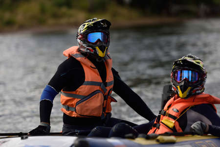 motorboat: St. Petersburg, Russia - August 15, 2015: Irina Krylova right and Dmitry Krylov prepare to the start of the second stage of the River marathon Oreshek Fortress race. This international motorboat competitions is held since 2003