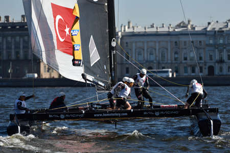 St. Petersburg, Russia - August 21, 2015: Catamaran of Team Turx of Turkey during the 2nd day of St. Petersburg stage of Extreme Sailing Series. Red Bull Sailing Team of Austria leading after the 1st day