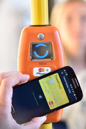 ticketing: St. Petersburg, Russia - August 17, 2015: Vice president of Mastercard in Russia Anton Shigapov demonstrate the PayPass technology in transport ticketing system implemented in the line 5 trolleybus Editorial