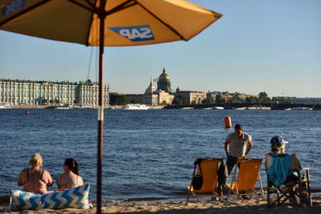 st german: St. Petersburg, Russia - August 21, 2015: People resting on the beach during the St. Petersburg stage of Extreme Sailing Series. German SAP SE is the official technical partner of the Series Editorial