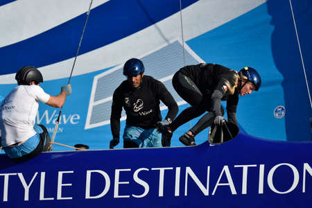 bowman: St. Petersburg, Russia - August 20, 2015: Bowman Nasser Al Mashari (center) and tactician Sarah Ayton (right) on the catamaran The Wave, Muscat of Oman during the 1st day of St. Petersburg stage of Extreme Sailing Series. The team are three-time overall S