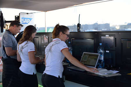st german: St. Petersburg, Russia - August 21, 2015: Staff processing statistics gathered by SAP software during the 2nd day of St. Petersburg stage of Extreme Sailing Series. German SAP SE is the official technical partner of the Series Editorial
