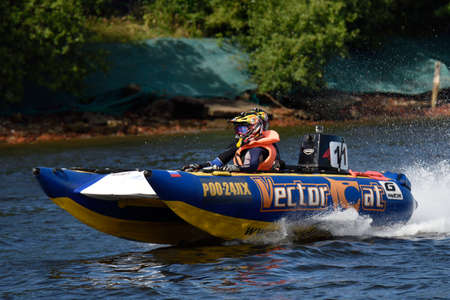 motorboat: St. Petersburg, Russia - August 15, 2015: Irina Krylova in front and Dmitry Krylov go to start of the River marathon Oreshek Fortress race. This international motorboat competitions is held since 2003 Editorial