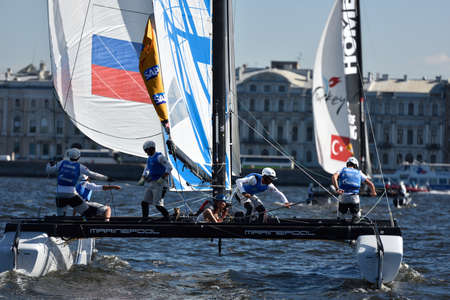 St. Petersburg, Russia - August 21, 2015: Catamaran of Gazprom Team Russia during the 2nd day of St. Petersburg stage of Extreme Sailing Series. Red Bull Sailing Team of Austria leading after the 1st day
