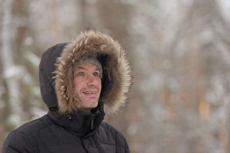 cowl: Mature man in winter clothes outdoors