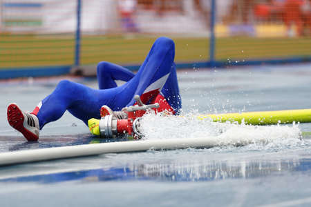 held down: St. Petersburg, Russia - September 9, 2015: Athlete of Czech Republic is down after competitions in combat deployment during the XI World Championship in Fire and Rescue Sport. First World Championship was held in 2002