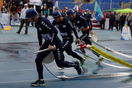 fire team: St. Petersburg, Russia - September 9, 2015: Team Korea during competitions in combat deployment during the XI World Championship in Fire and Rescue Sport. First World Championship was held in 2002 Editorial