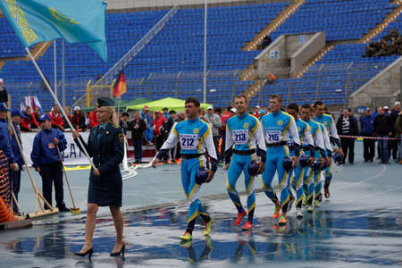fire team: St. Petersburg, Russia - September 9, 2015: Team Kazakhstan before competitions in combat deployment during the XI World Championship in Fire and Rescue Sport. First World Championship was held in 2002