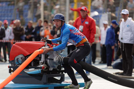 world championship: St. Petersburg, Russia - September 9, 2015: Team Russia during competitions in combat deployment during the XI World Championship in Fire and Rescue Sport. First World Championship was held in 2002