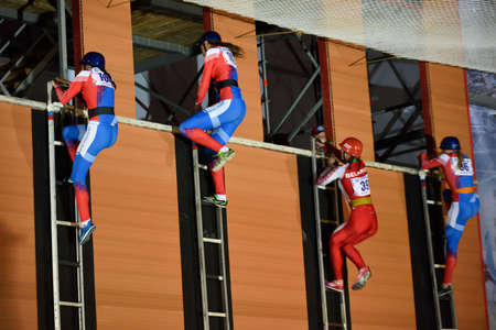 world championship: St. Petersburg, Russia - September 7, 2015: Semi-final female race in the rise of a hook ladder during the XI World Championship in Fire and Rescue Sport. First World Championship was held in 2002 Editorial