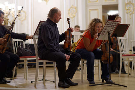 french horn: St. Petersburg, Russia - September 7, 2015: Musicians of the symphonic orchestra Nevsky on the rehearsal during the International festival of French horn. The hornfest is held 3rd time
