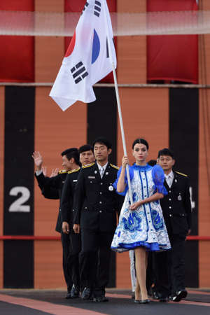 fire team: St. Petersburg, Russia - September 7, 2015: Team Korea during opening ceremony of the XI World Championship in Fire and Rescue Sport. First World Championship was held in 2002