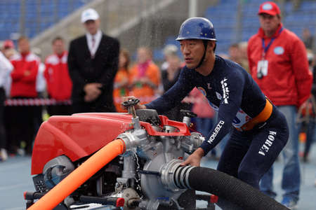world championship: St. Petersburg, Russia - September 9, 2015: Team Korea during competitions in combat deployment during the XI World Championship in Fire and Rescue Sport. First World Championship was held in 2002 Editorial